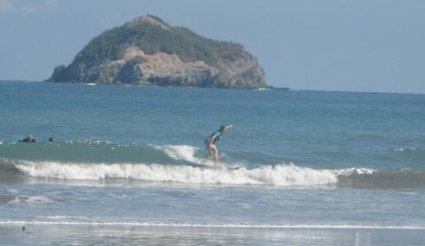 Surfing in Playa Manuel Antonio Beach, Costa Rica